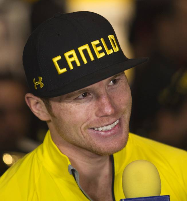 Super welterweight Canelo Alvarez of Mexico smiles during an interview following his weigh-in at the MGM Grand Arena on Friday, March 07, 2014.