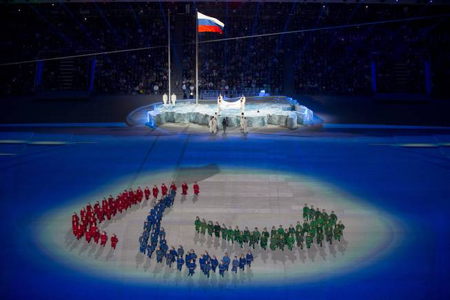 Actors perform at the Fisht Olympic stadium during the opening ceremony of the 2014 Winter Paralympics in Sochi, Russia, Friday, March 7, 2014.