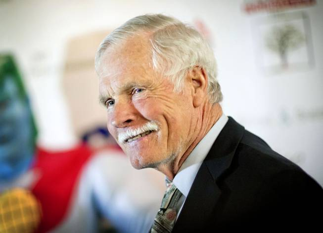 In this Friday, Dec. 6, 2013, file photo, American media mogul Ted Turner is photographed on the red carpet at the Captain Planet Foundation benefit gala in Atlanta.