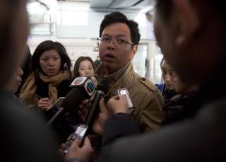 A Malaysian man who says he has relatives on board the missing Malaysian airline plane talks to journalists at Beijing's International Airport Beijing, China, Saturday, March 8, 2014. (AP Photo/Ng Han Guan)
