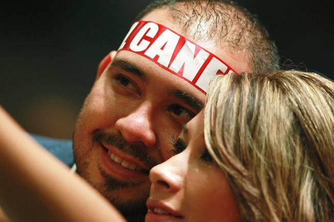 "Fans of Saul ""Canelo"" Alvarez take a photo of themselves before during his super welterweight fight against Alfredo Angulo at the MGM Grand Garden Arena Saturday, March 8, 2014."