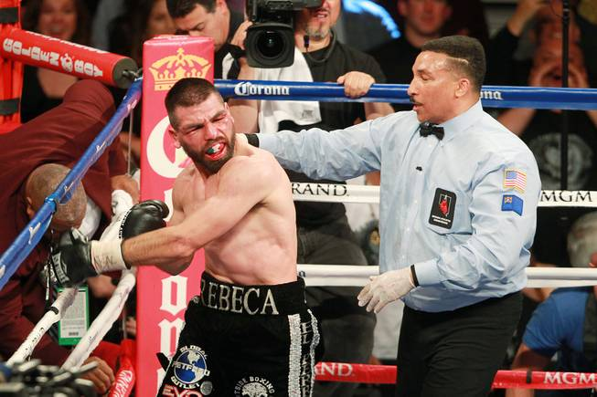 "Alfredo Angulo pulls away from referee Tony Weeks after Weeks called stopped his fight with Saul ""Canelo"" Alvarez during their super welterweight fight at the MGM Grand Garden Arena Saturday, March 8, 2014. Canelo won by TKO in the 10th round."
