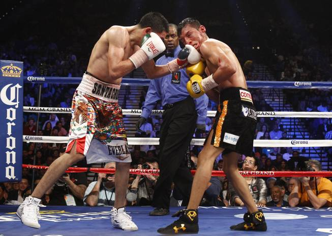 WBC super bantamweight champion Leo Santa Cruz, left, connects on Cristian Mijares, both of Mexico, during their title fight at the MGM Grand Garden Arena on Saturday, March 8, 2014.