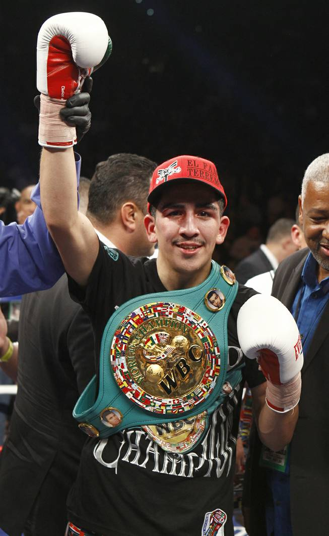 WBC super bantamweight champion Leo Santa Cruz celebrates his victory over Cristian Mijares, both of Mexico, after their title fight at the MGM Grand Garden Arena on Saturday, March 8, 2014.