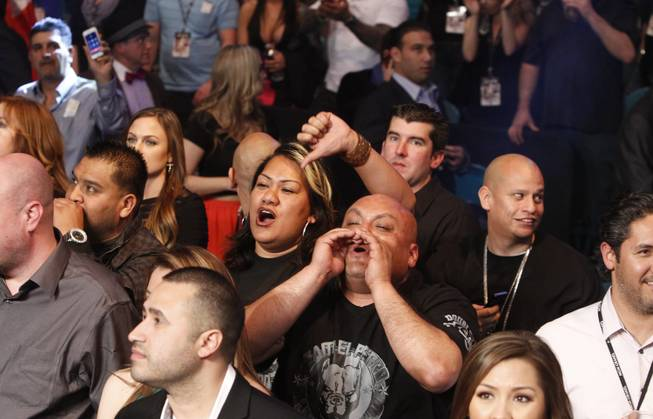 Angry Alfredo Angulo fans show their displeasure after referee Tony Weeks stopped the fight in the 10th round at the MGM Grand Garden Arena on Saturday, March 8, 2014.