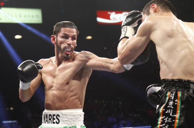 Jorge Linares, left, of Venezuela punches throws a punch at Nihito Arakawa of Japan during their lightweight fight at the MGM Grand Garden Arena on Saturday, March 8, 2014.