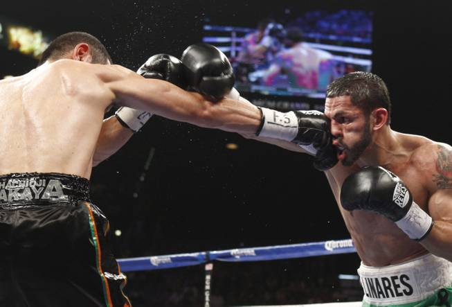 Nihito Arakawa of Japan connects on Jorge Linares of Venezuela during their lightweight fight at the MGM Grand Garden Arena on Saturday, March 8, 2014.