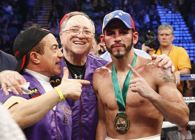 Jorge Linares, right, of Venezuela celebrates his victory over Nihito Arakawa of Japan after their lightweight fight at the MGM Grand Garden Arena on Saturday, March 8, 2014.