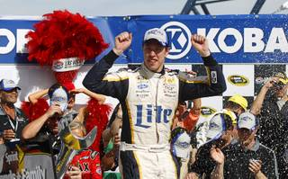 Brad Keselowski celebrates in victory lane after winning the Kobalt 400 NASCAR Sprint Cup Series race Sunday, March 9, 2014, at Las Vegas Motor Speedway.