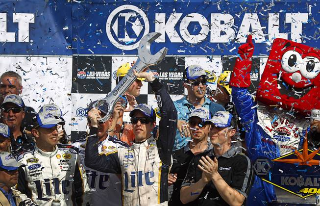 Brad Keselowski holds his trophy in victory lane after winning the Kobalt 400 NASCAR Sprint Cup Series race at the Las Vegas Motor Speedway Sunday, March 9, 2014.