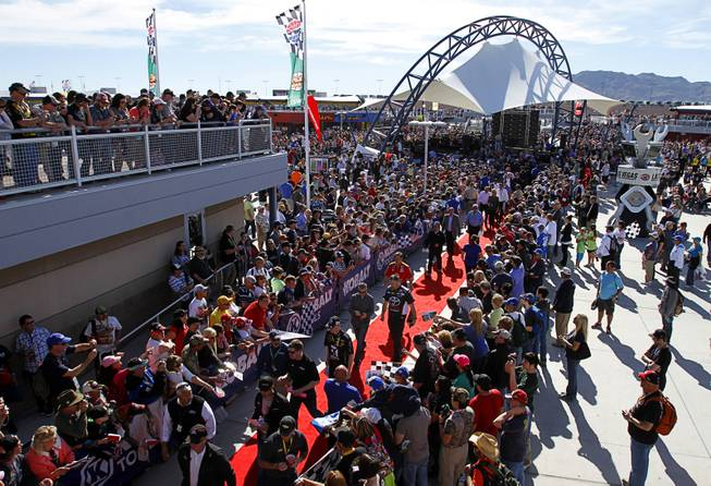 Fans wait for drivers and celebrities before the Kobalt 400 NASCAR Sprint Cup Series race at the Las Vegas Motor Speedway Sunday, March 9, 2014.