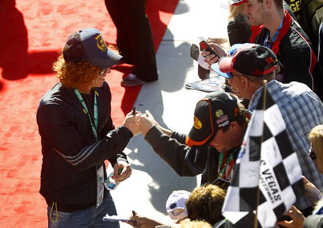 Comedian Carrot Top visits with fans before the Kobalt 400 NASCAR Sprint Cup Series race at the Las Vegas Motor Speedway Sunday, March 9, 2014.