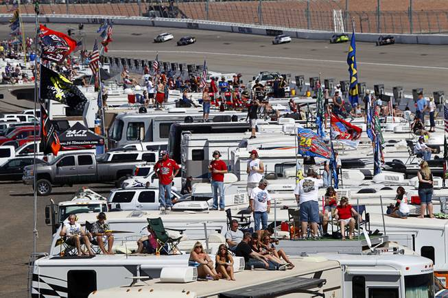 Fans watch from recreational vehicles in the infield during the Kobalt 400 NASCAR Sprint Cup Series race at the Las Vegas Motor Speedway Sunday, March 9, 2014.