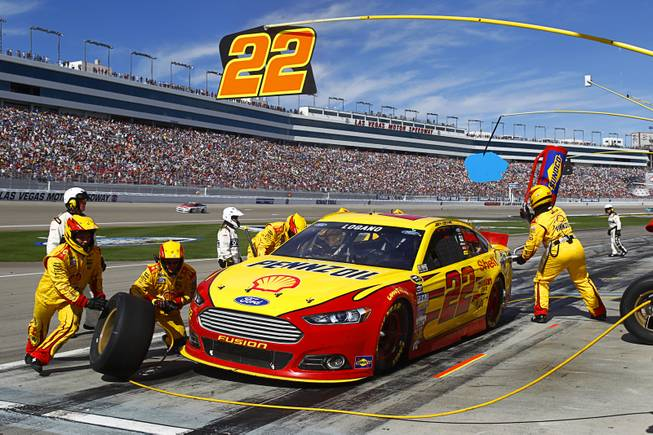 Pole winner Joey Logano comes in for a pit stop during the Kobalt 400 NASCAR Sprint Cup Series race at the Las Vegas Motor Speedway Sunday, March 9, 2014.