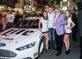 D Las Vegas owner Derek Stevens, in a lilac blazer, hosts a meet-and-greet with NASCAR star Brad Keselowski at his casino resort Thursday, March 6, 2014, in downtown Las Vegas.