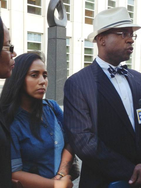 In this July 3, 2013, file photo, former Metropolitan Detention Center guard Nancy Gonzalez, center, listens as her attorney, Anthony Rico, speaks to members of the media outside the federal courthouse in the Brooklyn borough of New York. Gonzalez gained notoriety by conceiving a baby behind bars with a cop killer. Although she claims to have had clandestine sexual encounters with at least eight co-workers and a second inmate while on duty at the Metropolitan Detention Center, it remains unclear if anyone else has been disciplined.