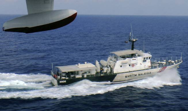 In this photo released by Malaysian Maritime Enforcement Agency, a patrol vessel of Malaysian Maritime Enforcement Agency searches for the missing Malaysia Airlines plane off Tok Bali Beach in Kelantan, Malaysia, on Sunday, March 9. Military radar indicates that the missing Boeing 777 jet may have turned back, Malaysia's air force chief said Sunday as scores of ships and aircraft from across Asia resumed a hunt for the plane and its 239 passengers.