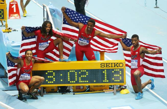 United States relay team, from left, Kind Butler, David Verburg, Calvin Smith and Kyle Clemons celebrate after winning the 4x400m relay with a new world record during the Athletics World Indoor Championships in Sopot, Poland, on Sunday, March 9.