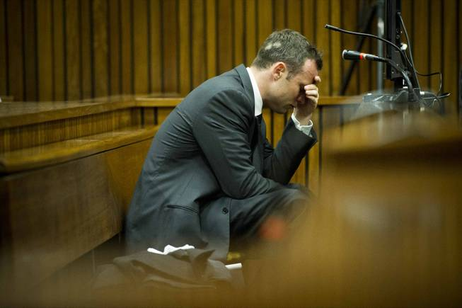 Oscar Pistorius puts his hand to his head while listening to cross questioning about the events surrounding the shooting death of his girlfriend, Reeva Steenkamp, during his trial in Pretoria, South Africa, on Friday, March 7. Pistorius is charged with murder for the shooting death of Steenkamp on Valentines Day 2013.