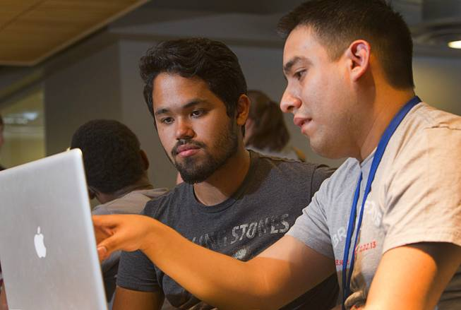 George Rivas, left, a Chapparral High School senior, listens to mentor Alberto Alvarado, a software engineer, during a workshop for first annual Congressional Science, Technology, Engineering and Math (STEM) Academic Competition, also known as the House App Contest, at Zappos in downtown Las Vegas Monday, March 10, 2014. The national contest for high school students, established by members of the U.S. House of Representatives in 2013, involves developing an app and creating a video demonstration to explain it.