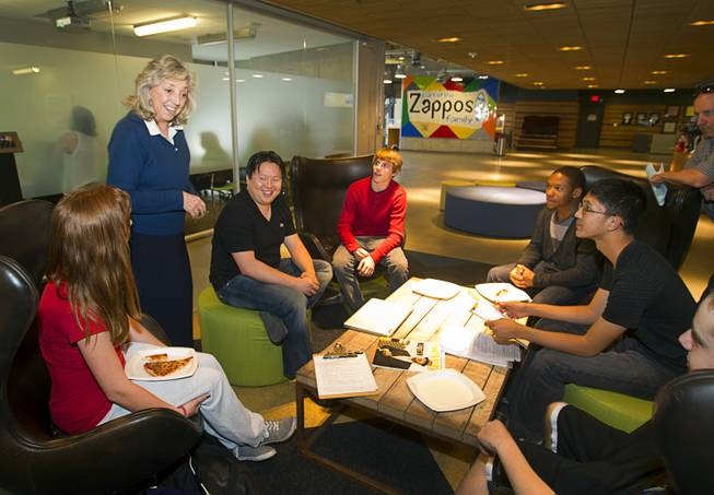 U.S. Congresswoman Dina Titus, standing left, (D-NV) visits a workshop for first annual Congressional Science, Technology, Engineering and Math (STEM) Academic Competition, also known as the House App Contest, at Zappos in downtown Las Vegas Monday, March 10, 2014. The national contest for high school students, established by members of the U.S. House of Representatives in 2013, involves developing an app and creating a video demonstration to explain it.