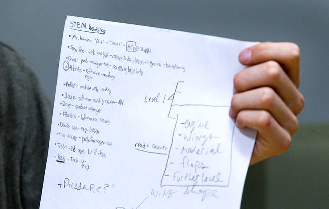 A student holds up notes during a workshop for first annual Congressional Science, Technology, Engineering and Math (STEM) Academic Competition, also known as the House App Contest, at Zappos in downtown Las Vegas Monday, March 10, 2014. The national contest for high school students, established by members of the U.S. House of Representatives in 2013, involves developing an app and creating a video demonstration to explain it.