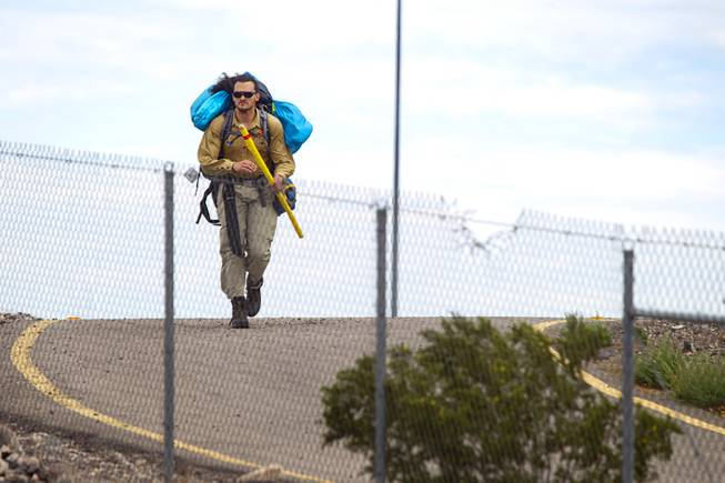 "Robert Sorensen, 27, heads out for a walk from Henderson to Israel Monday, March 10, 2014. Sorensen said he is not a religious man but that it was a ""spiritual"" journey. Sorensen estimated the trip to be 16,500 miles."