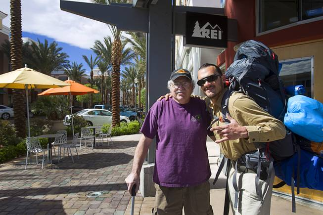 "Robert Sorensen, 27, poses with his father Rick Sorensen before heading out on a walk from Henderson to Israel Monday, March 10, 2014. Sorensen said he is not a religious man but that it was a ""spiritual"" journey. Sorensen estimated the trip to be 16,500 miles."