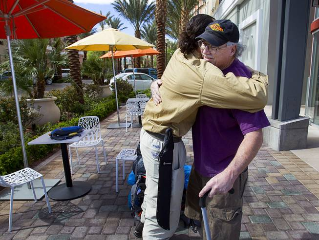 "Robert Sorensen, 27, hugs his father Rick Sorensen before leaving on a walk from Henderson to Israel Monday, March 10, 2014. Sorensen said he is not a religious man but that it was a ""spiritual"" journey. Sorensen estimated the trip to be 16,500 miles."