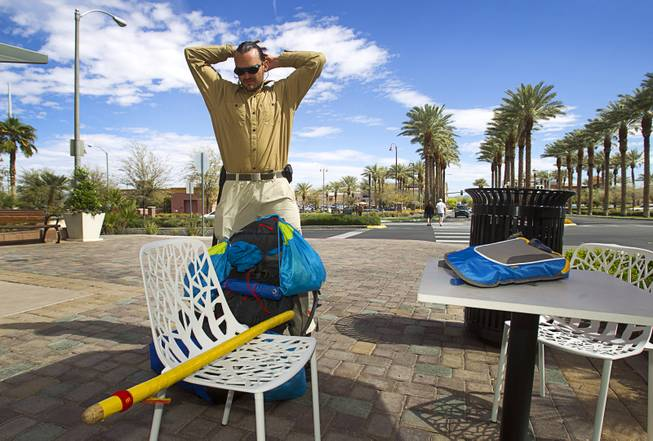 "Robert Sorensen, 27, prepares for a walk from Henderson to Israel Monday, March 10, 2014. Sorensen said he is not a religious man but that it was a ""spiritual"" journey. Sorensen estimated the trip to be 16,500 miles."