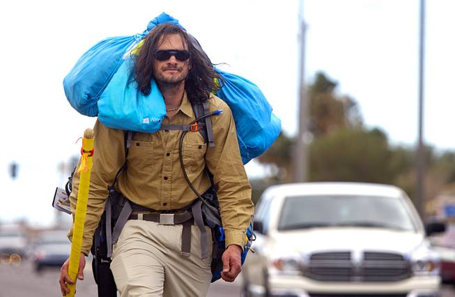"Robert Sorensen, 27, heads north on Pecos Road as he sets off on a walk from Henderson to Israel Monday, March 10, 2014. Sorensen said he is not a religious man but that it was a ""spiritual"" journey. Sorensen estimated the trip to be 16,500 miles."