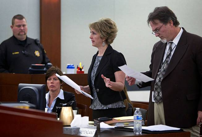 Attorney Lisa Zastrow, center, representing the Animal Foundation, speaks during a hearing at the Regional Justice Center Tuesday, March 11, 2014. Steven Sweiker, center, Clark County Deputy District Attorney, listens at right. Judge Kenneth Cory kept a temporary restraining order in place preventing an Animal Foundation raffle of puppies rescued in a  Jan. 27 fire at the Prince and Princess Pet Shop. An evidentiary hearing is scheduled for March 19.