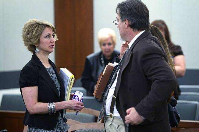 Attorney Lisa Zastrow, left, representing the Animal Foundation, speaks with Steven Sweiker, center, Clark County Deputy District Attorney, during a hearing at the Regional Justice Center Tuesday, March 11, 2014. Judge Kenneth Cory kept a temporary restraining order in place preventing an Animal Foundation raffle of puppies rescued in a  Jan. 27 fire at the Prince and Princess Pet Shop. An evidentiary hearing is scheduled for March 19.