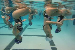 The Nevada Desert Mermaid synchronized swim team practices Tuesday, March 11, 2014.
