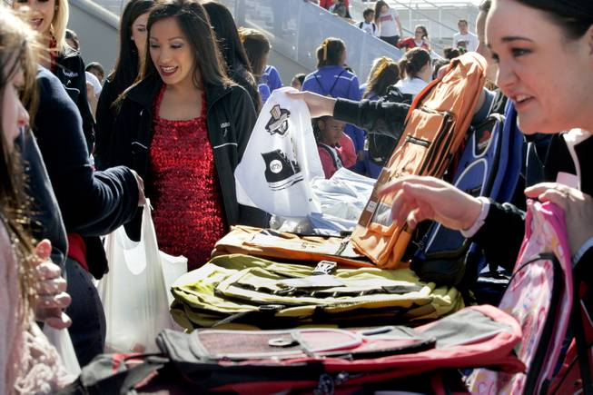 Students also receive new backpacks and t-shirts during the Goodie Two Shoes Foundation event at the Thomas & Mack Center Tuesday, March 11, 2014.