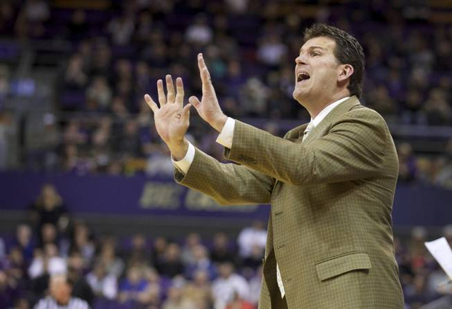 UCLA head coach Steve Alford yells in the second half of an NCAA college basketball game against Washington, Thursday March 6, 2014, in Seattle. UCLA won 91-82.