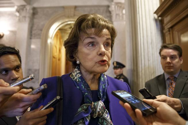 Senate Intelligence Committee Chair Sen. Dianne Feinstein, D-Calif. talks to reporters as she leaves the Senate chamber on Capitol Hill in Washington, Tuesday, March 11, 2014.