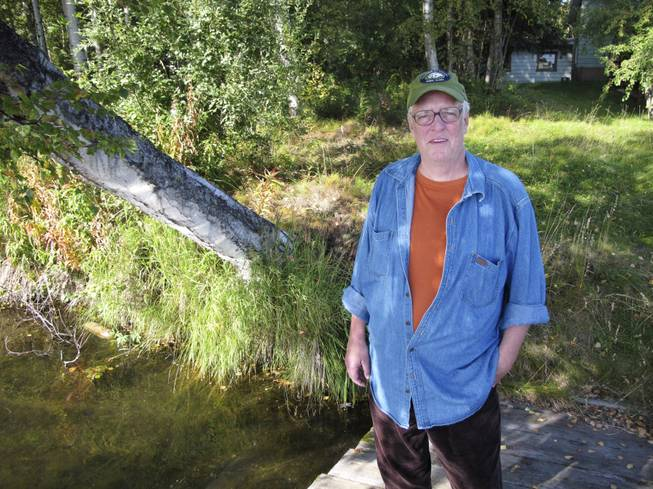 In this Sept. 3, 2010, file photo, author Joe McGinniss, who was working on a book on former Alaska Gov. Sarah Palin, stands near the home he rented next to Palin's home in Wasilla, Alaska.
