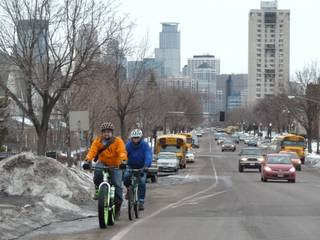 People ride bikes in Minnesota year round. Even in the dead of winter when temperatures go below zero and the snowdrifts dwarf houses. Here, two winter riders, Nick Mason, left, and Dorian Grilley of the Bicycle Alliance of Minnesota, negotiate a road in the winter in Minneapolis, March 11, 2014.