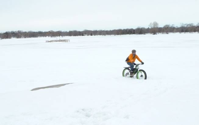 People ride bikes in Minnesota year round. Even in the dead of winter when temperatures go below zero and the snowdrifts dwarf houses. Here, Nick Mason, of the Bicycle Alliance of Minnesota, negotiates some wintry scenes, March 11, 2014.