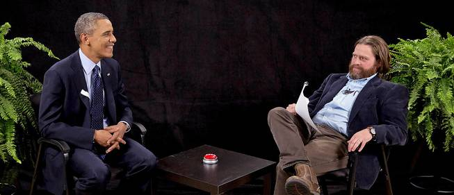 "This image from video shows President Obama, left, with actor-comedian Zach Galifianakis during an appearance on ""Between Two Ferns,"" the digital short with a laser focus on reaching people aged 18 to 34."