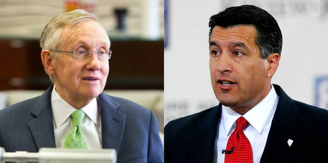 Nevada's political heavyweights, U.S. Sen. Harry Reid, leader of the state's Democrats, left, and Gov. Brian Sandoval, leader of Nevada Republicans, right.