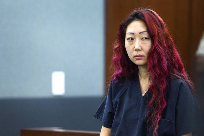 Pet shop owner Gloria Lee appears in court at the Regional Justice Center Wednesday, March 12, 2014. Lee and co-defendant Kirk Bills pleaded not guilty to charges of torching the pet shop where 27 puppies were rescued, and a judge rejected a bid for lower bail.