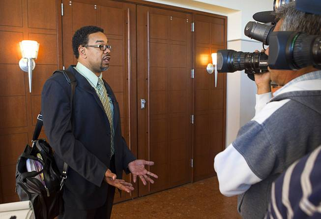 Defense attorney Roger Bailey, representing Kirk Bills, answers questions from reporters following an arraignment at the Regional Justice Center Wednesday, March 12, 2014. Bills and pet shop owner Gloria Lee pleaded not guilty to charges of torching the pet shop where 27 puppies were rescued, and a judge rejected a bid for lower bail.