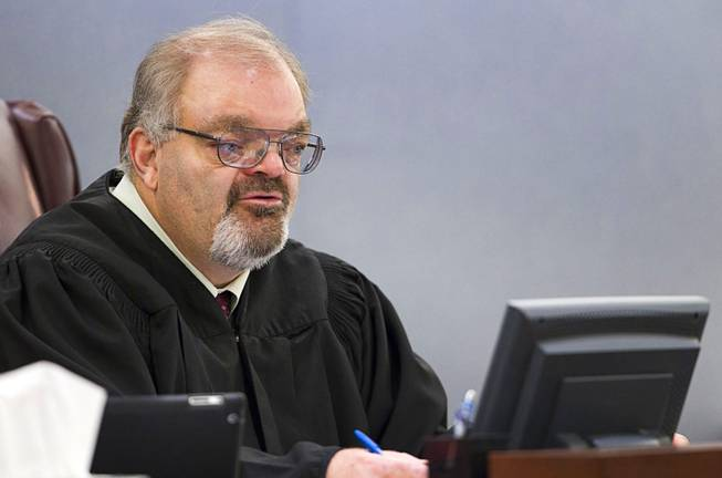 Judge Conrad Hafen speaks to attorneys during Christine Allen's court appearance at the Regional Justice Center Wednesday, March 12, 2014. Allen told police that she drowned her 3-year-old son because of voices in her head, according to a Metro Police arrest report.