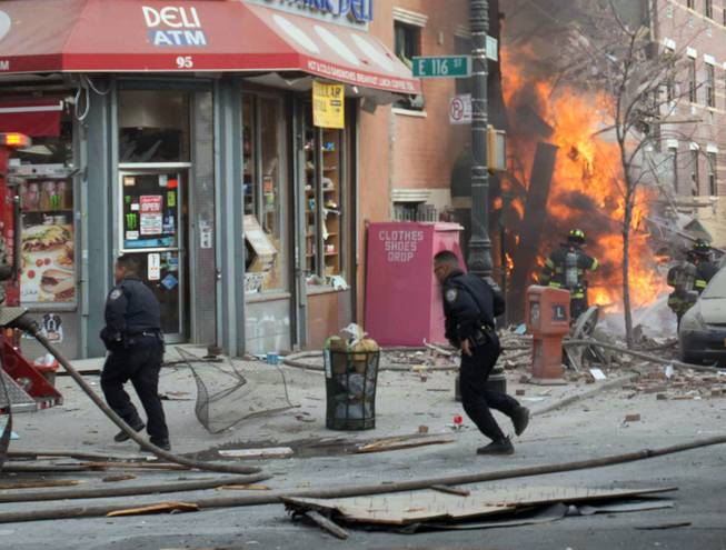 Emergency crews respond to an explosion that leveled two apartment buildings in the East Harlem neighborhood of New York, Wednesday, March 12, 2014. The blast happened after a neighbor reported smelling natural gas.