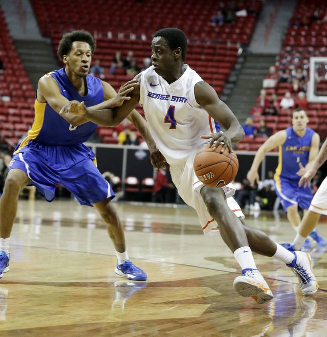 Boise State's Thomas Bropleh drives past San Jose State's Ryan Watkins during the second half of a Mountain West Conference men's tournament NCAA college basketball game Wednesday, March 12, 2014, in Las Vegas. Boise State defeated San Jose State 83-52. (AP Photo/Isaac Brekken)