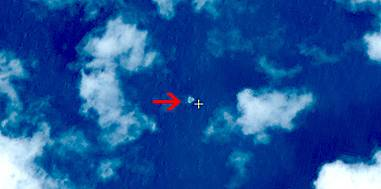 In this March 9, 2014, satellite image seen on the website of the Chinese State Administration of Science, Technology and Industry for National Defense, floating objects are seen at sea next to the red arrow which was added by the source.