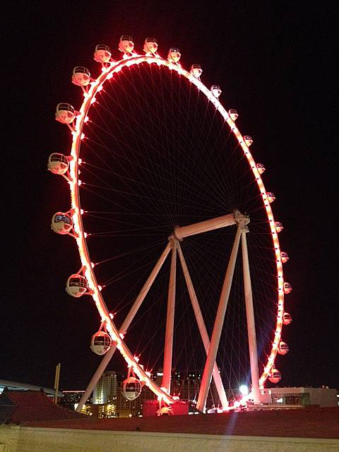A nighttime view of the Las Vegas High Roller observation wheel, Wednesday, March 12, 2014.