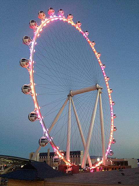 A view of the Las Vegas High Roller observation wheel at dusk, Wednesday, March 12, 2014.